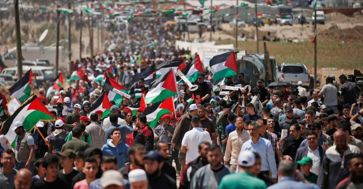 Palestinian demonstrators gather east of Gaza City in the Gaza Strip, May 15, 2019, during a protest marking the 71th anniversary of Nakba u2014 also known as Day of the Catastrophe in 1948.