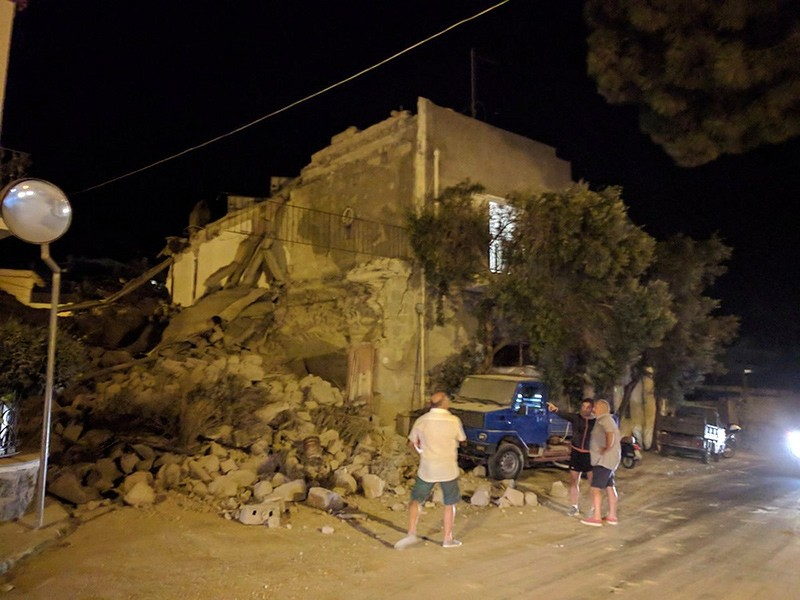 This Monday, Aug. 21, 2017 photo, shows people standing near a collapsed building following an earthquake in Casamicciola on the Italian resort island of Ischia (AP Photo)