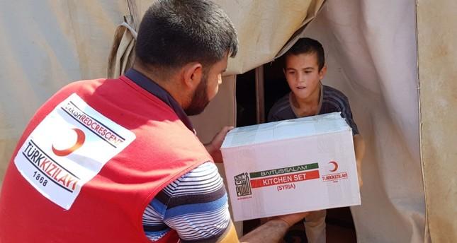 Turkey increases humanitarian efforts in Idlib as tension grows
