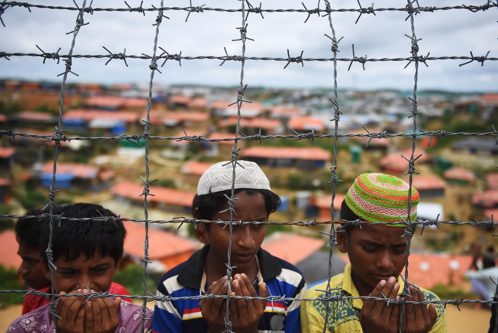 Rohingya refugees perform prayers on the first anniversary of Myanmar military crackdown at the Kutupalong refugee camp, Ukhia, Aug. 25.