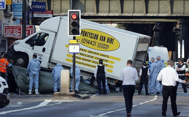 Forensic officers move the van at Finsbury Park in north London, where a vehicle struck pedestrians in north London Monday, June 19, 2017. The vehicle struck pedestrians near a mosque in north London early Monday morning. (AP Photo)