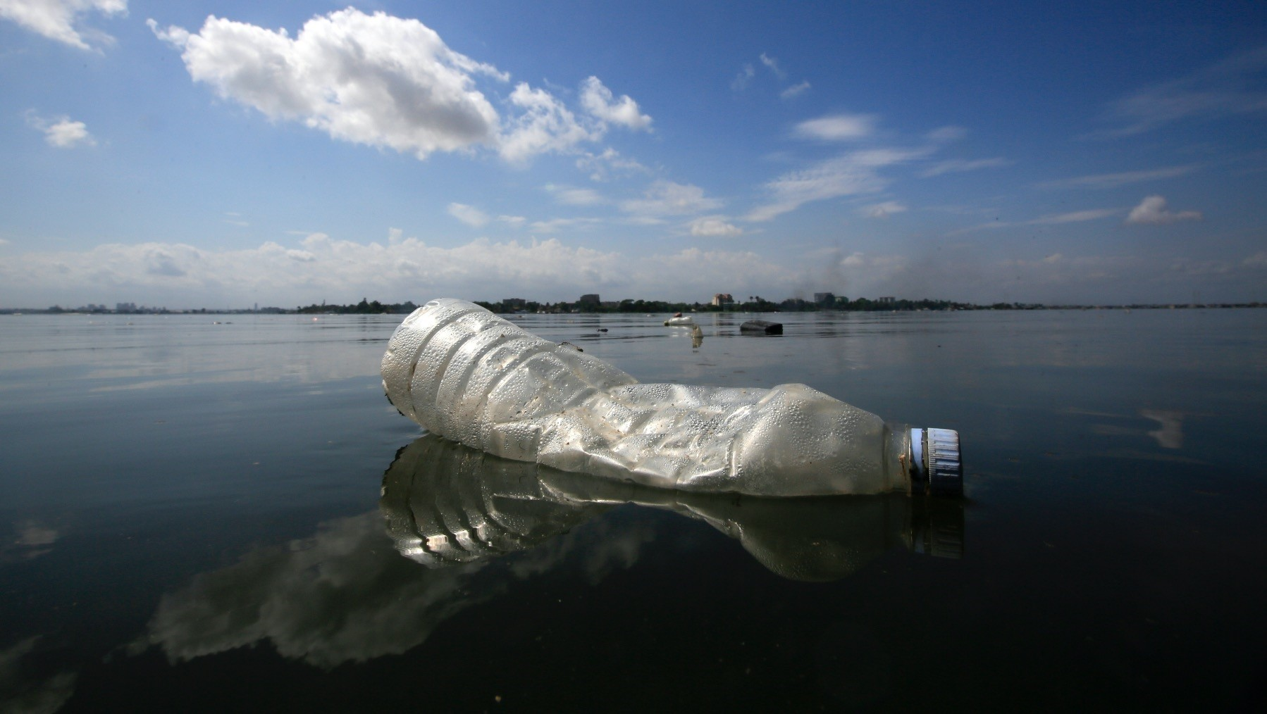 A plastic bottle floats on the Ebrie Lagoon in the city of Abidjan, Ivory Coast.