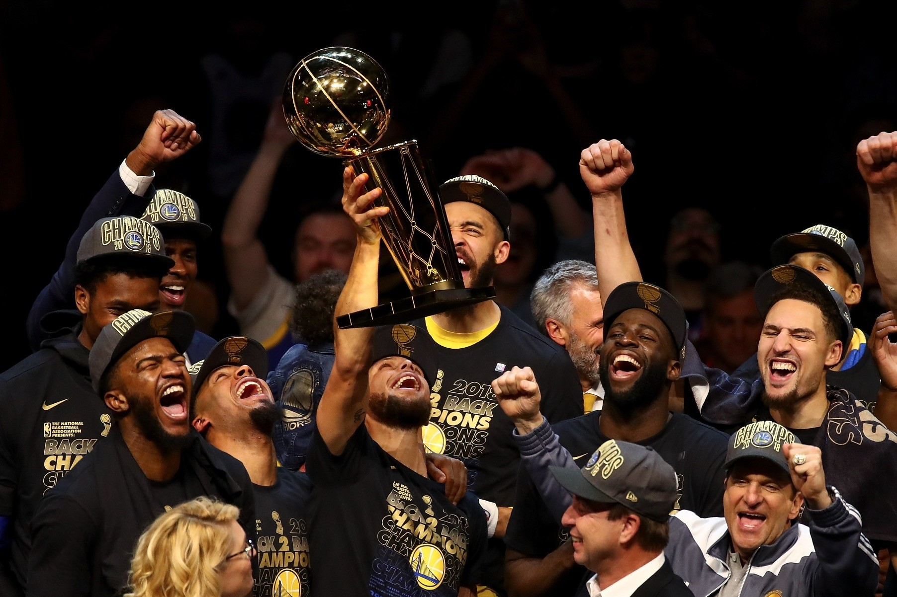 The Golden State Warriors celebrate with the Larry Ou2019Brien Trophy after defeating the Cleveland Cavaliers in Game 4 of the 2018 NBA Finals at Quicken Loans Arena  June 8 in Cleveland.