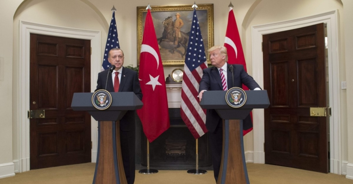 In this file photo taken on May 16, 2017 US President Donald Trump and Turkish President Recep Tayyip Erdogan speak to the press in the Roosevelt Room of the White House in Washington, DC. (AFP Photo)