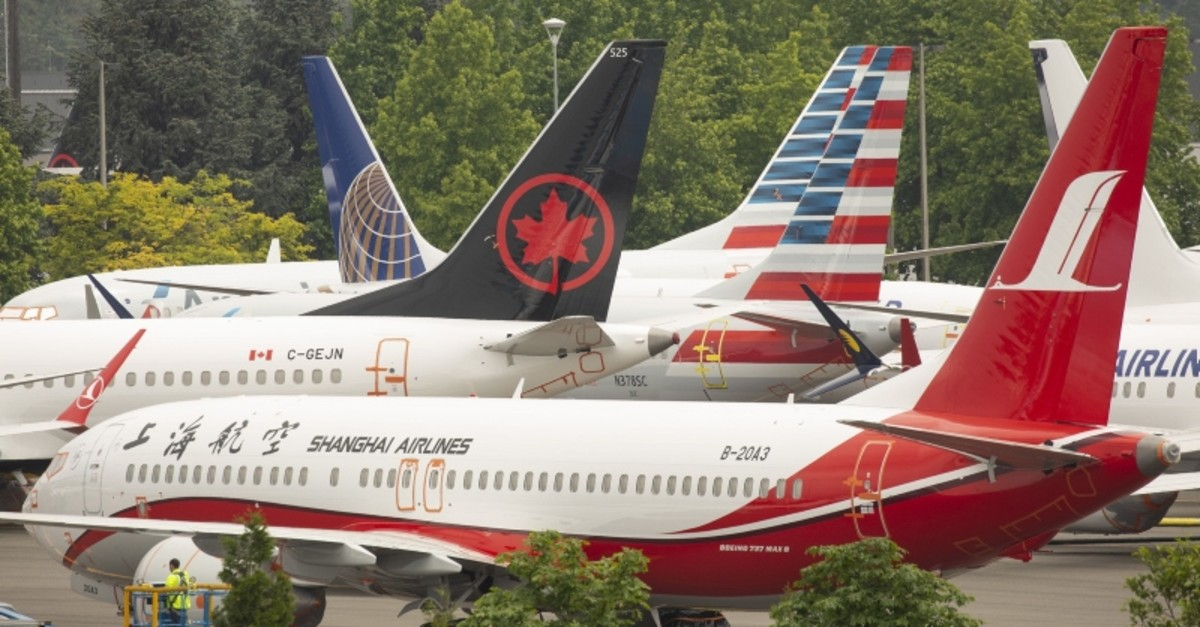 The tails of Boeing 737 MAX airplanes are seen as they sit parked at a Boeing facility adjacent to King County International Airport, known as Boeing Field, on May 31, 2019 in Seattle, Washington. (AFP Photo)