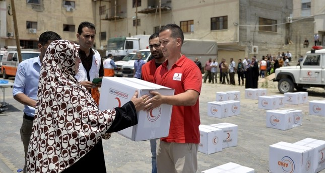 Turkish Red Crescent officials deliver aid to Palestinian families in Gaza.