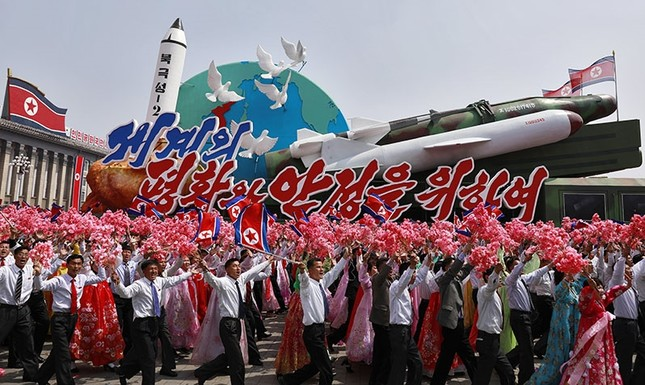 North Korean people waving flowers march with a float carrying replicas of missiles during a parade for the 'Day of the Sun' festival on Kim Il Sung Square in Pyongyang, North Korea, 15 April 2017.  (EPA Photo)