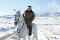 Kim rides white horse up North Korea's sacred peak