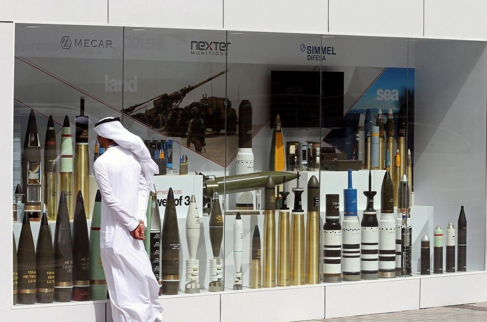 A visitor looks at munitions on display during the International Defense Exhibition and Conference (IDEX) in Abu Dhabi, United Arab Emirates, Feb. 19.