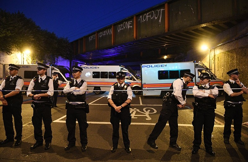 Policemen stand by a police cordon near Finsbury Park, after a van collision incident in north London, Britain, 19 June 2017 (EPA Photo)