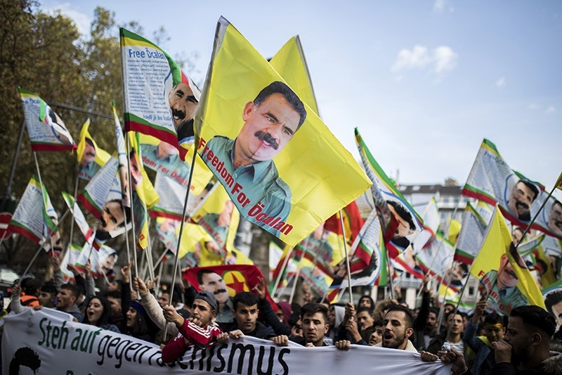 Supporters of the PKK terror group wave flags showing the group's leader Abdullah u00d6calan during a protest in Duesseldorf, Germany, Nov. 4, 2017. (DPA Photo)