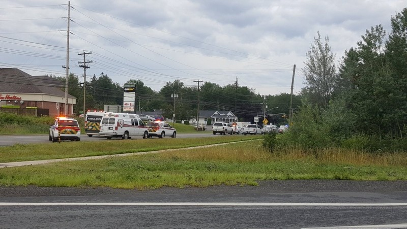 Emergency vehicles are seen at the Brookside Drive area in Fredericton, Canada August 10, 2018 in this picture obtained from social media. (Kev Bourque/via REUTERS)