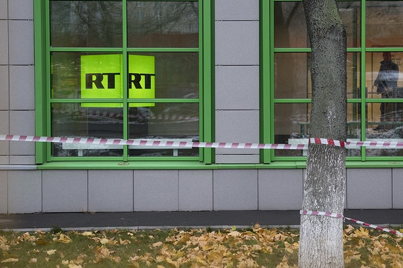 Russian state-owned television station RT logo is seen at the window of the company's office in Moscow, Russia, Friday, Oct. 27, 2017. (AP Photo)