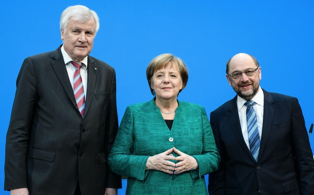 (From left to right) CSU leader Seehofer,  CDU leader and Chancellor Merkel and SPD leader Schulz during a press statement following coalition talks, Berlin, Feb. 7.