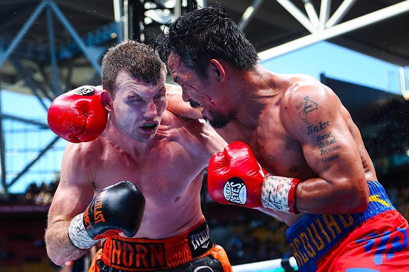 Manny Pacquiao (R) of the Philippines fight Jeff Horn (L) of Australia during the World Boxing Organization boat at Suncorp Stadium in Brisbane on July 2, 2017. (AFP Photo)