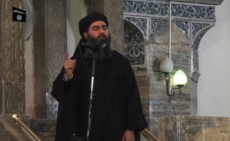 An image grab taken from a propaganda video released on July 5, 2014 by al-Furqan Media allegedly shows the leader of Daesh, Abu Bakr al-Baghdadi, adressing worshippers at a mosque in Iraq's Mosul. (AFP Photo)