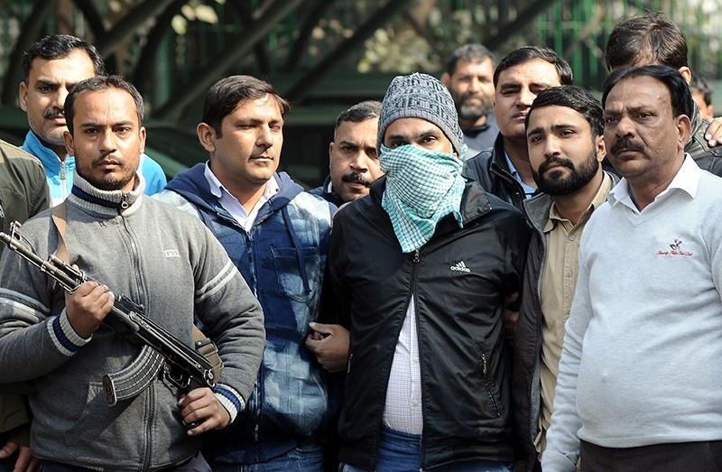 Indian police bring Abdul Subhan Qureshi, center, a suspected terrorist belonging to Students' Islamic Movement of India (SIMI) and Indian Mujahideen groups, in front of media in New Delhi, India, Jan. 22, 2018. (EPA Photo)