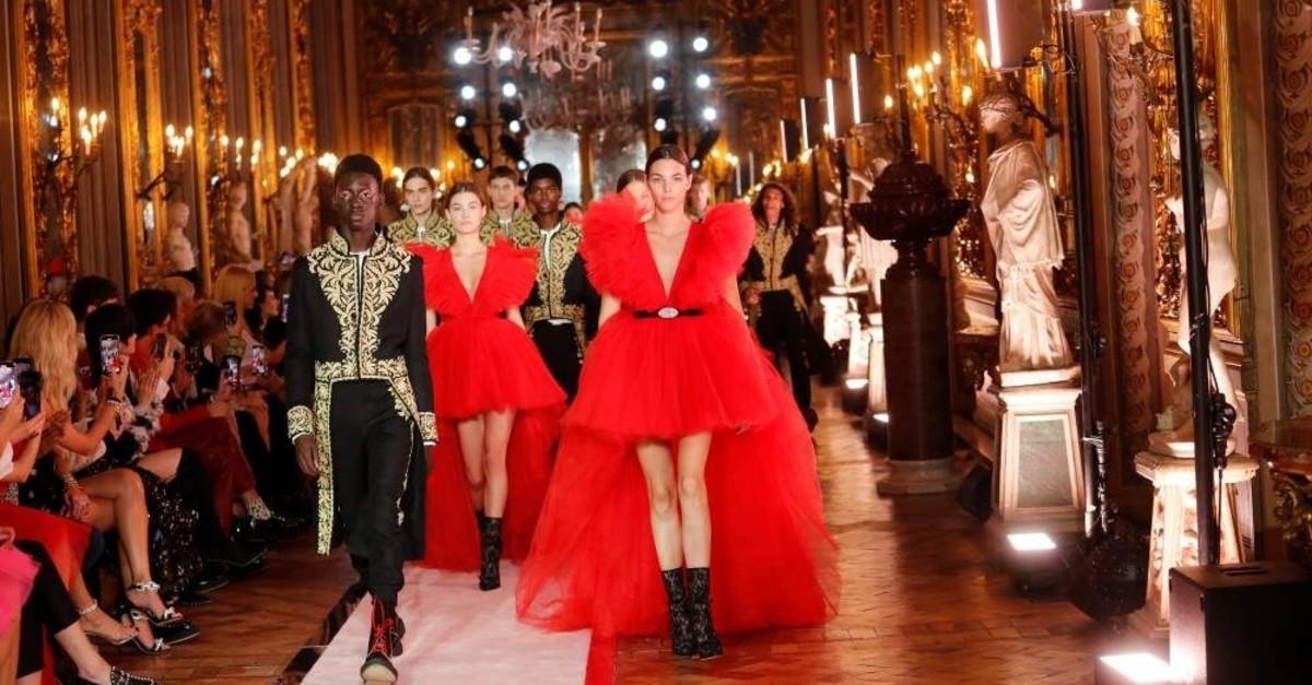 Models present creations of designer Giambattista Valli and retailer H&M in Rome, Italy Oct. 24, 2019. (REUTERS)