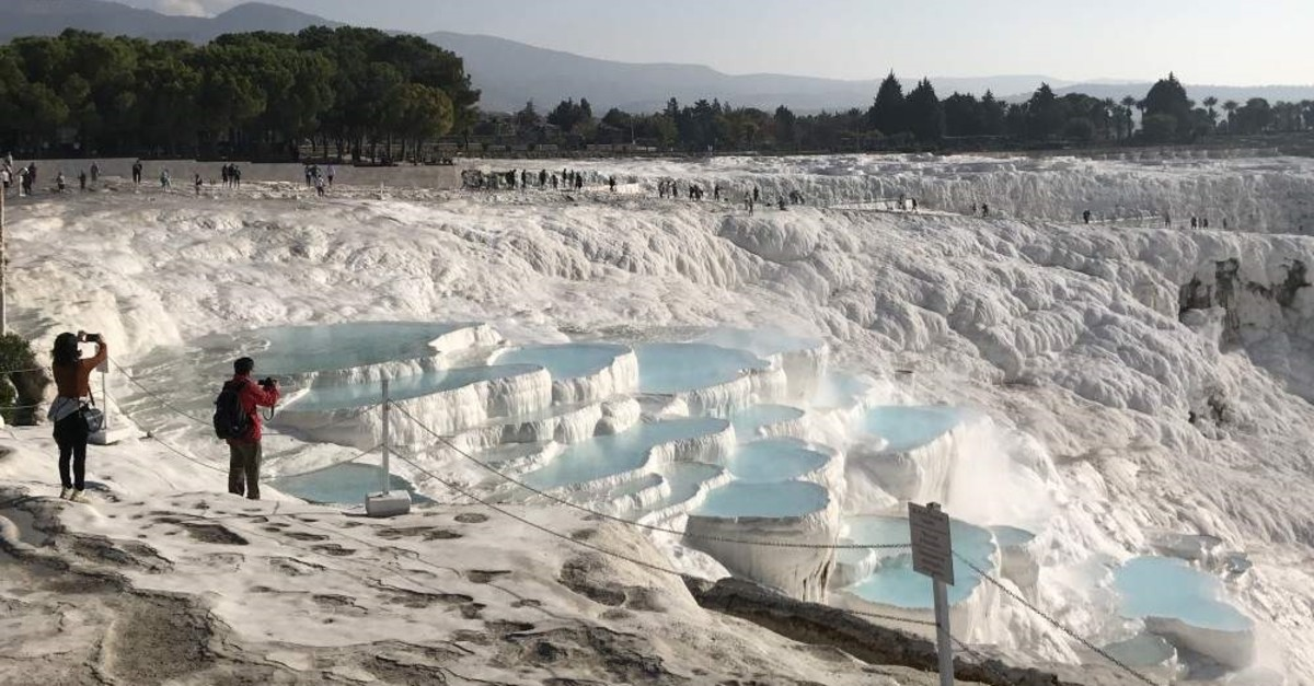 Pamukkale, world-renowned as a travertine paradise, is expected to welcome 2.6 million visitors by the end of this year. (AA Photo)