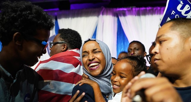 Ilhan Omar, the first Somali-American member of the Congress, celebrates with her children after her victory in Minnesota's Fifth Congressional District in the midterm elections, Aug. 14.
