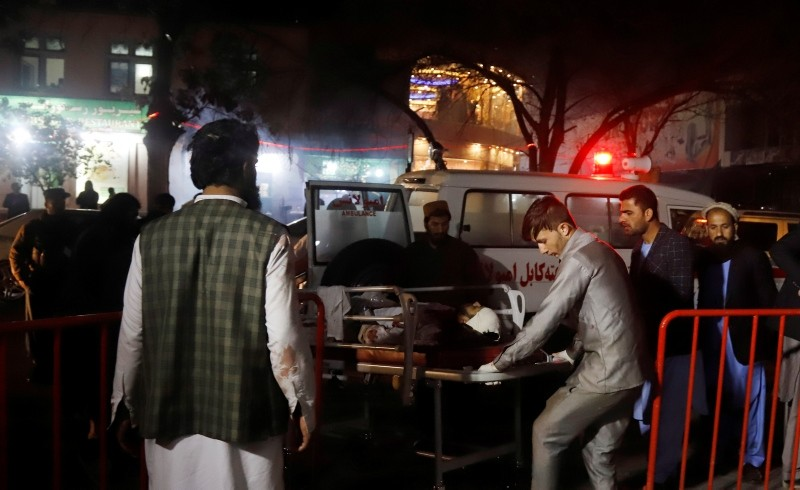 Afghan health workers carry an injured person outside the emergency hospital after a suicide attack targeted a wedding hall, in Kabul, Afghanistan, Nov. 20, 2018. (EPA Photo)