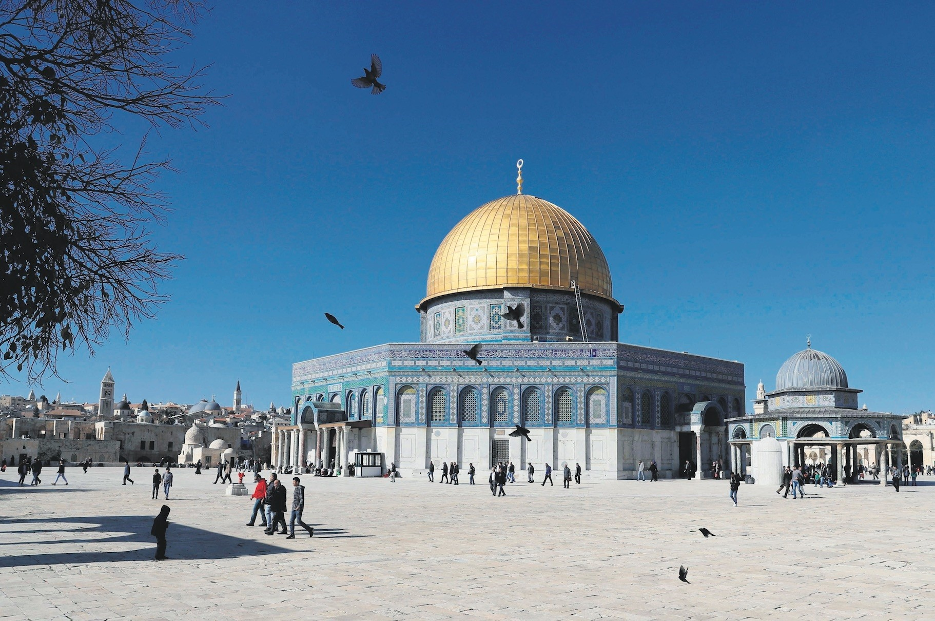Palestinian Muslim worshippers walk past the Dome of the Rock at the Al-Aqsa Mosque compound in Jerusalemu2019s Old City after U.S. President Trumpu2019s decision to recognize Jerusalem as the capital of Israel.