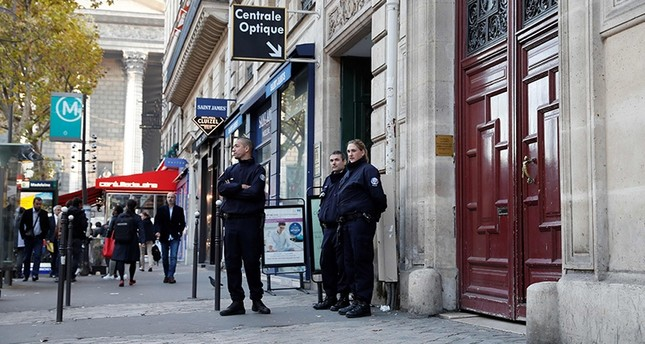This file photo taken at the Rue Tronchet, near Madeleine, central Paris, on October 3, 2016 shows police officers standing guard at the entrance of the hotel residence (AFP Photo)