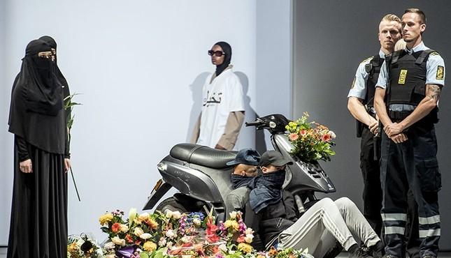 Models display creations by Iranian born designer Reza Etamadi during a MUF10 fashion show in Copenhagen, Wednesday, Aug. 8, 2018. (AP Photo)