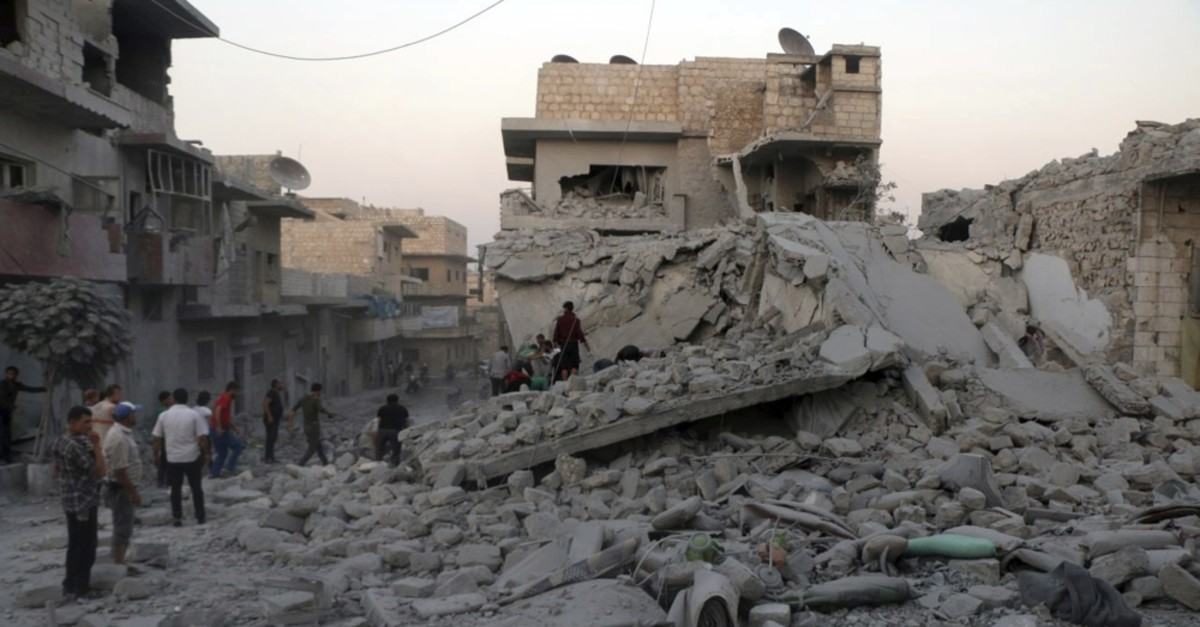 People searching for victims under the rubble of destroyed buildings that were hit by regime airstrikes in the northern town of Maaret al-Numan, Idlib, Syria Aug. 29, 2019.