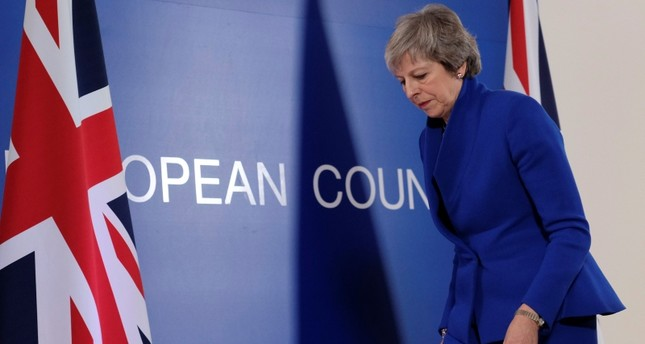 UK PM May delays Brexit vote amid widespread opposition