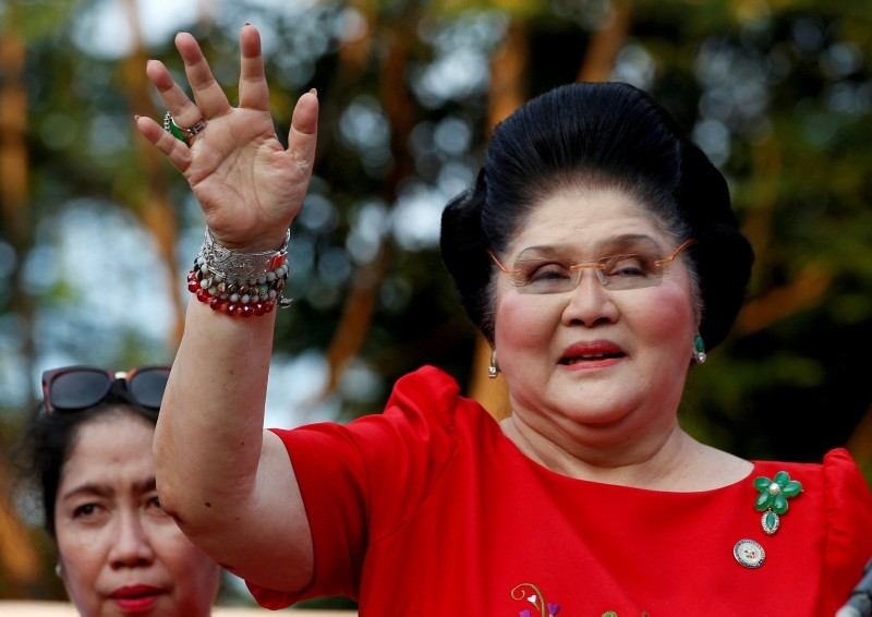 Philippines Former First Lady and Congresswoman Imelda Marcos waves to supporters as she takes part in the announcement of her son BongBong Marcos' vice-presidential candidacy, in Manila Philippines October 10, 2015. (Reuters Photo)