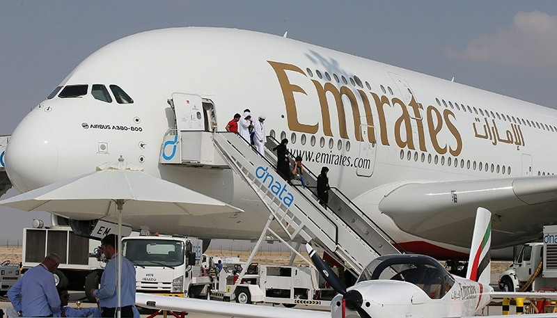 Visitors depart from Airbus A 380 owned by Emirates airlines after inspecting the airplane at the exhibition of the Dubai Air show 2013 at Dubai Al Maktoum international airport in the United Arab Emirates (EPA Photo)