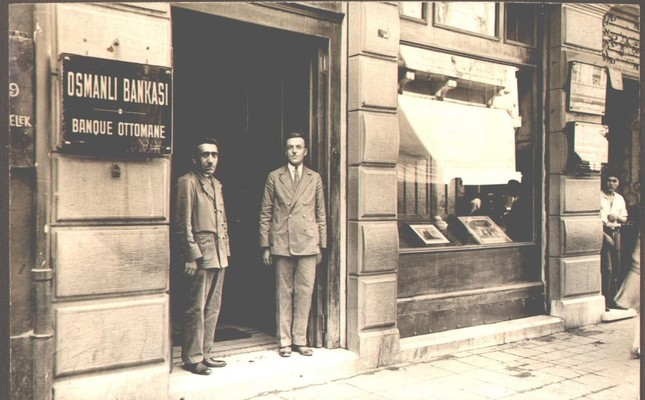 Two men stand at the entrance of the Ottoman Bank's Beyoğlu branch circa 1930.