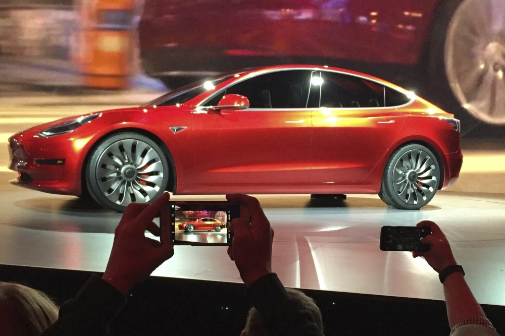 In this March 31, 2016, file photo, Tesla Motors unveiled the new lower-priced Model 3 sedan at the Tesla Motors design studio in Hawthorne, Cal.