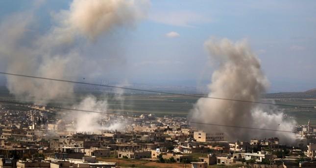 Smoke billows following intense shelling in Khan Sheykun in Syria's northwestern Idlib province, May 10, 2019.