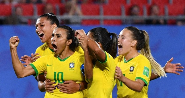Brazil's forward Marta (2ndL) is congratulated by teammates after scoring a goal during the France 2019 Women's World Cup Group C football match between Italy and Brazil, on June 18, 2019, at the Hainaut Stadium in Valenciennes. (AFP Photo)