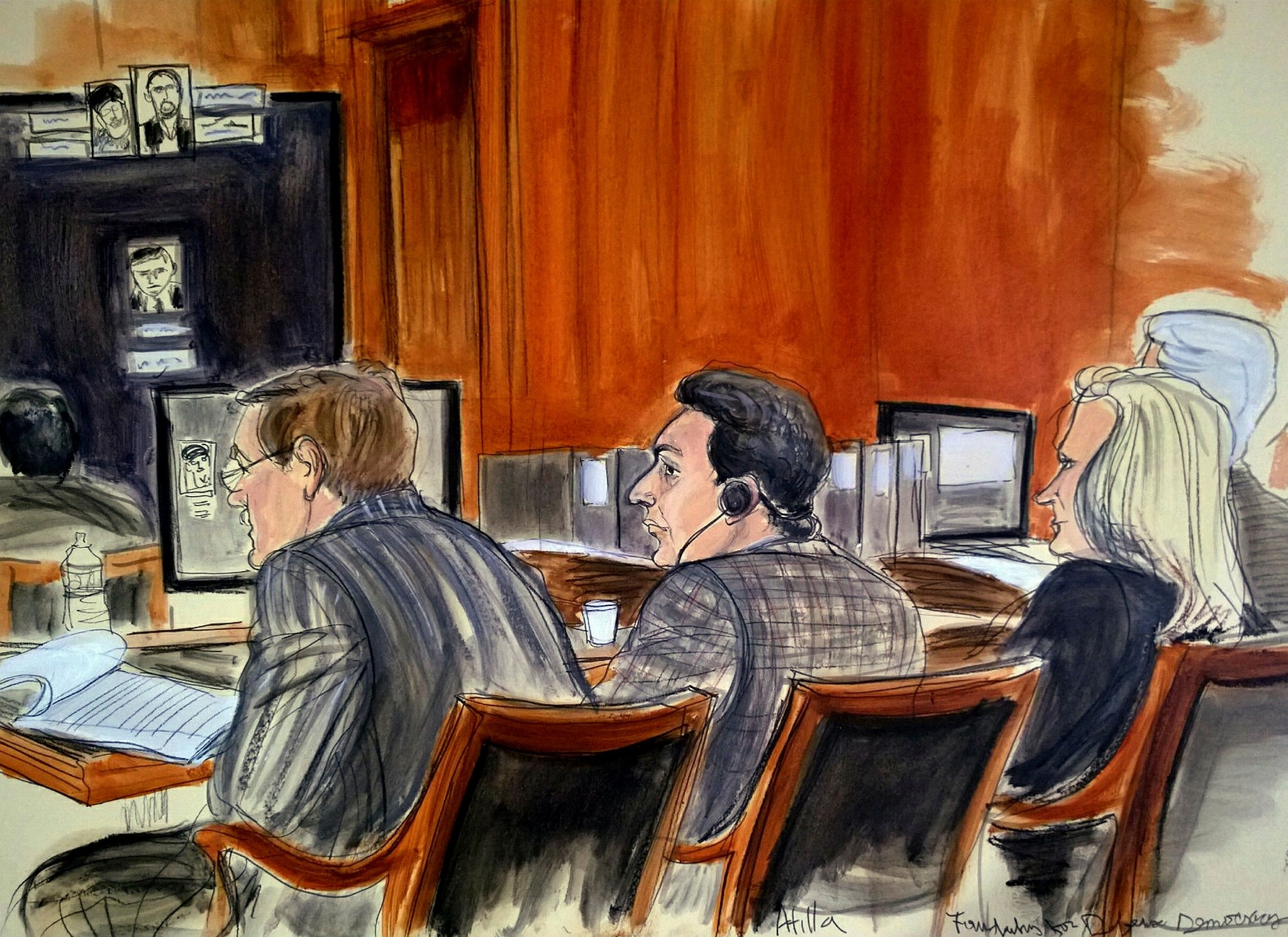 In this Nov. 28, 2017 court room sketch, defendant, Mehmet Hakan Atilla, center, listens to proceedings from the defense table, in New York (AP Photo)
