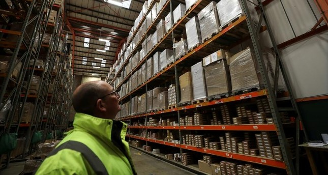 An employee looks up at goods at the Miniclipper Logistics warehouse in Leighton Buzzard, December 3, 2018. Reuters Photo