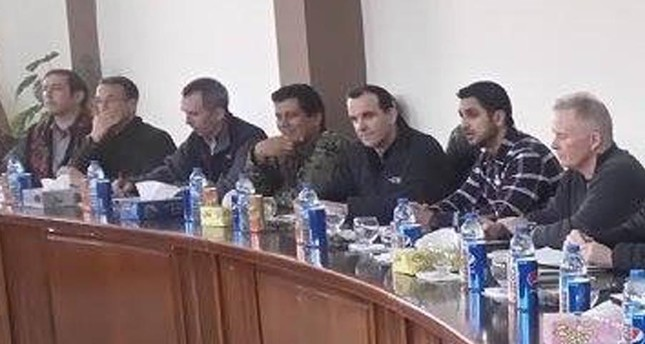 Trump's special envoy to Deash (third from the right) sits side by side with the most wanted PKK terrorist Şahin Cilo at a meeting in Kobani in 2016.