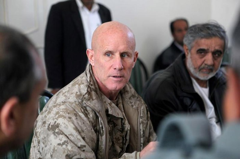 Vice Adm. Robert S. Harward, commanding officer of Combined Joint Interagency Task Force 435, speaks to an Afghan official during his visit to Afghanistan, in this Jan 6, 2011 handout photo. (Reuters Photo)