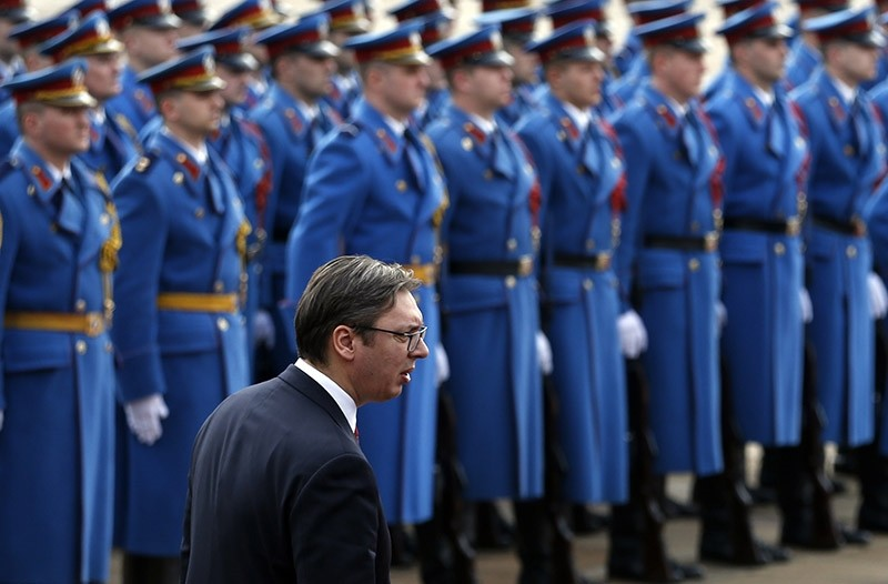 Serbian PM Aleksandar Vucic reviews the honor guard during a welcoming ceremony for Montenegro's PM Dusko Markovic, at the Serbia Palace in Belgrade, Serbia on Friday, Feb. 3, 2017. (AP Photo)