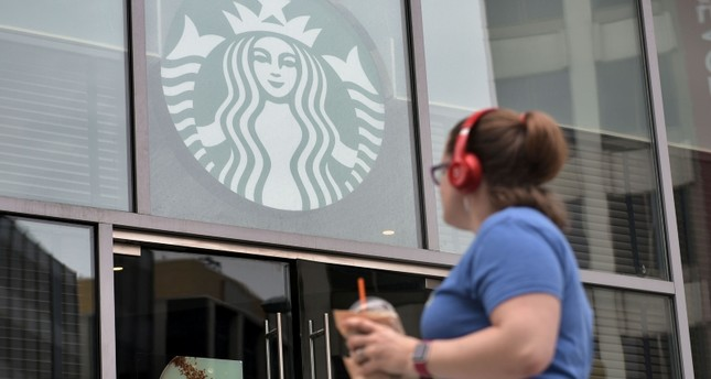 In this file photo taken on May 29, 2018 a woman is seen in front of a Starbucks shortly before it closes early for anti-bias training in Washington, DC. (AFP Photo)