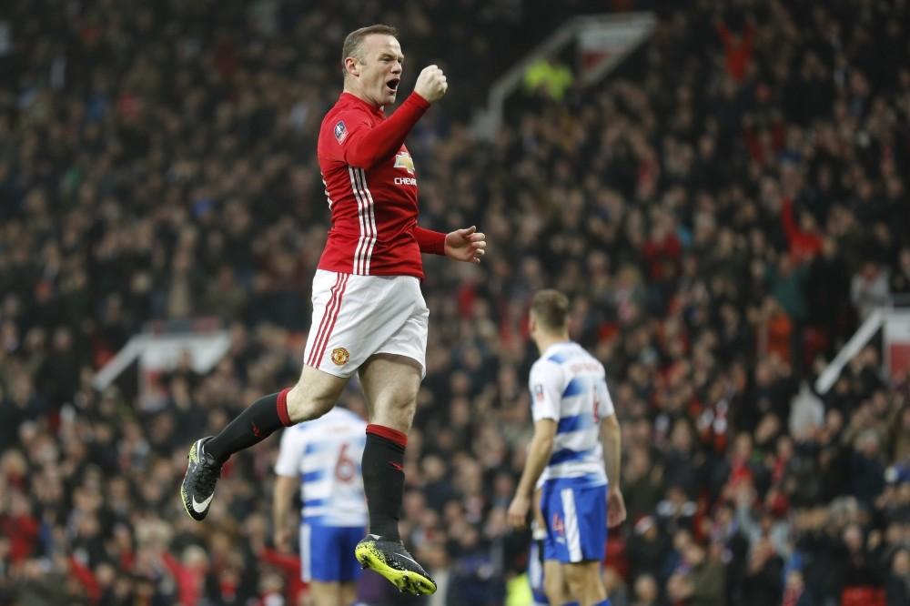 Manchester Unitedu2019s Wayne Rooney celebrates scoring their first goal.