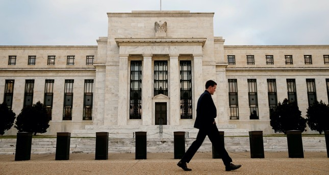 A man walks past the Federal Reserve Bank in Washington, D.C., Dec. 16, 2015.