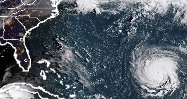This NOAA/RAMMB satellite image taken at 11:45 UTC on September 10, 2018, shows Hurricane Florence off the US east coast in the Atantic Ocean. (AFP Photo)
