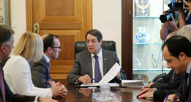 Greek Cypriot leader Nicos Anastasiades talks with Special Advisor to the UN Secretary-General on Cyprus, Espen Barth Eide, during their meeting at the Presidential Palace in Nicosia, Cyprus, 25 May 2017.