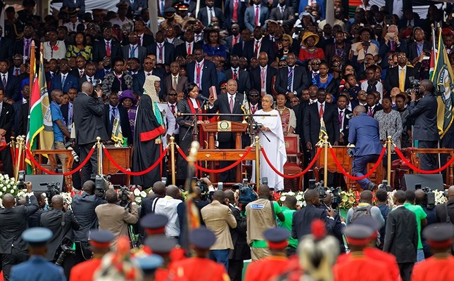 Kenyan President Uhuru Kenyatta, center, is sworn-in accompanied by his wife Margaret, center-right, during his inauguration ceremony at Kasarani stadium in Nairobi, Kenya, Nov. 28, 2017. (AP Photo)