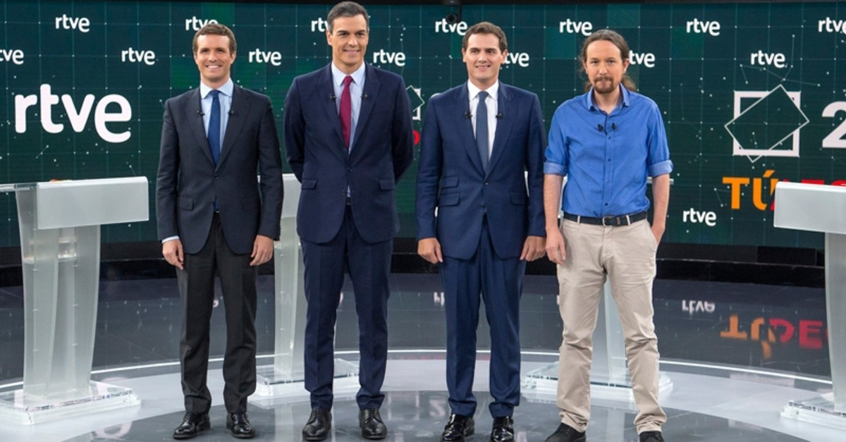 The main candidates pose before a live general election debate in the RTVE studios in Madrid, Spain, April 22, 2019. (L-R PP / Pablo Casado, PSOE / PM Pedro Sanchez, Ciudadanos / Albert Rivera and Podemos / Pablo Iglesias. (Raul Tejedor, RTVE via AP)