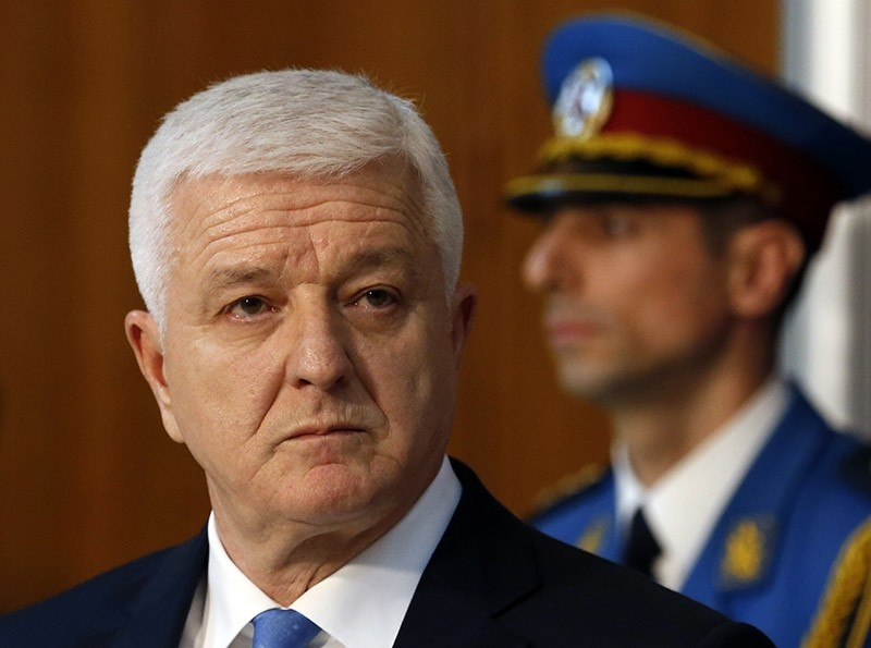 Montenegro's PM Dusko Markovic listens to his Serbian counterpart Aleksandar Vucic, not pictured, during a press conference after talks at the Serbia Palace in Belgrade, Serbia on Feb. 3, 2017. (AP Photo)