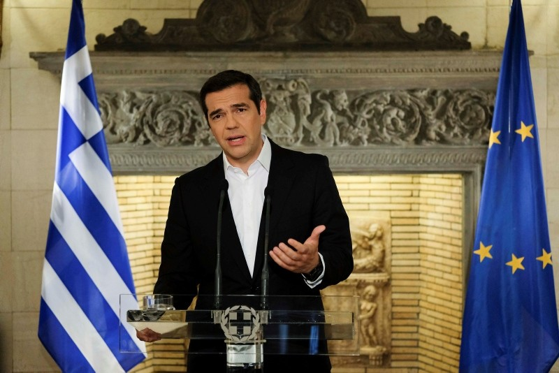 In this file photo, Greek Prime Minister Alexis Tsipras speaks during a televised address to the nation, in Athens, June 12, 2018. (Greek Prime Minister's Office via AP)